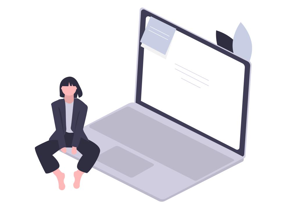 女性がパソコンの端に座っている